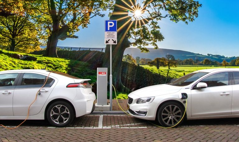 2 Electric Cars At Charging Station